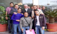 Photograph of Zahi Hawass with reps from Youth Movement