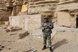 Photograph of Soldier guarding one of the tomb entrances at Saqqara